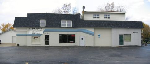street view of store front and repair garage